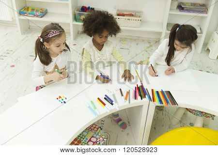 Multiracial Children Drawing In The Playroom