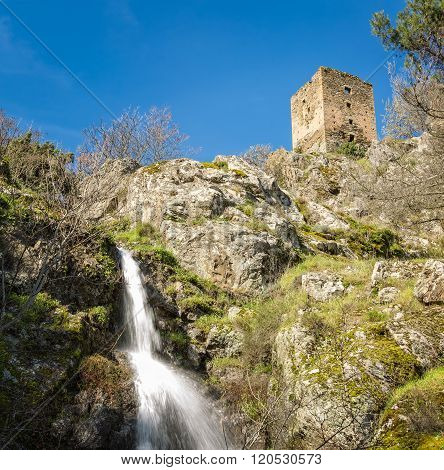 Waterfall & Ancient Stone Tower At Castifao In Corsica
