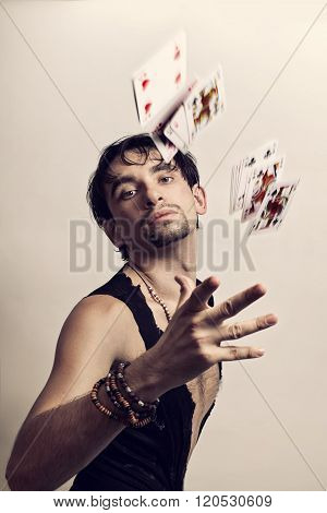 Man Throws Playing Cards