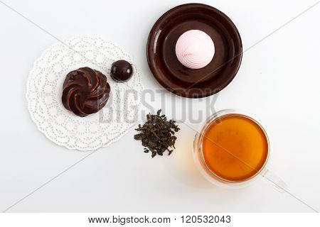 Double Sided Wall Glass Cup Full Of Green Tea With Sweets And Biscuits