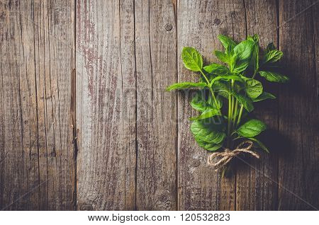 Fresh herbs from garden on an old table