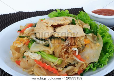 Rice Noodles Stir-fried with Chicken (Guay Tiew Kua Gai), Thai Street Food.