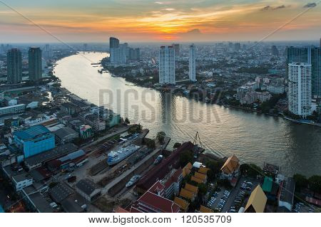 Sunset over Bangkok downtown with main river curved, Thailand