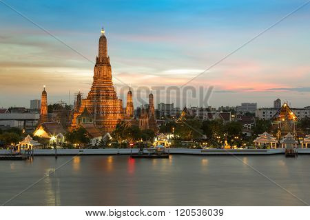 Arun pagoda temple waterfront after sunset, The most famous tourist destination of Thailand