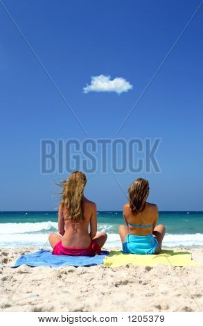 Two Young, Healthy Sexy Women Sitting On A Sunny Beach