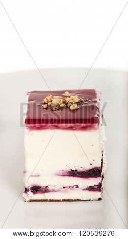 Strawberry Cheesecake Isolated on White Background. Dessert Piece of Cake on White Plate with Strawberries. Cake with Strawberry Topping Isolated. Close-Up Image of Homemade Delicious Strawberry Cake