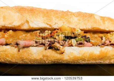 Close Up Of Italian Sub Long Baguette With Ham Cheese Tomato And Lettuce
