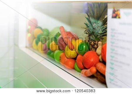 Heap Of Fresh Fruits And Vegetables Exposed In White Glass Shelf
