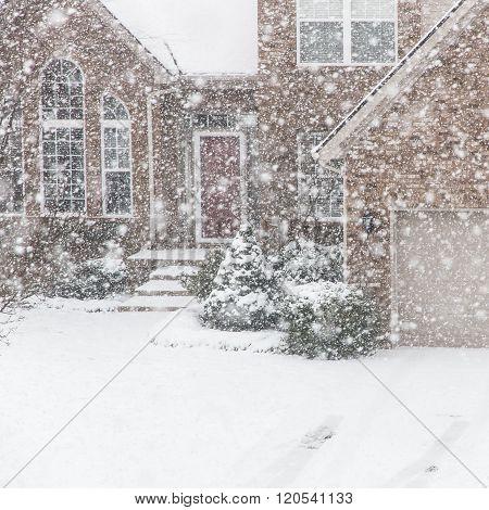 House on a street in a heavy snowfall.