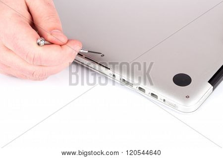 Technician Repairing Laptop At Desk