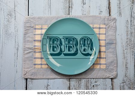 Empty Plate With Bbq Icon On Light Blue Wooden Background
