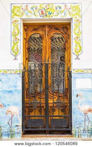 CALPE,SPAIN - FEBRUARY 22, 2016:    Wooden door on an old building Alicante. Spain.