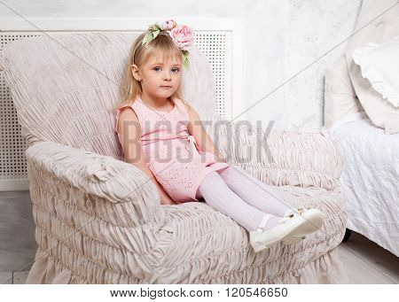 Portrait Of A Little Blonde Girl  Sitting In The Chair