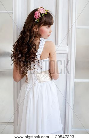 Tender Brunette Girl Standing Near The Door