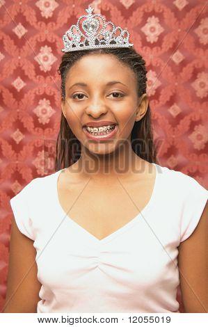 Portrait of teenage girl wearing crown