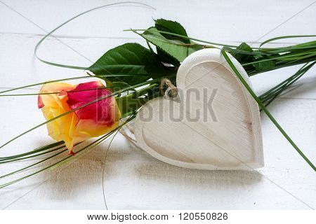 Rose And An Blank Wooden Heart On White Painted Wood, Concept For Love, Valentines, Mothers Or Women