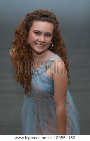 Pageant teen with cheery disposition.