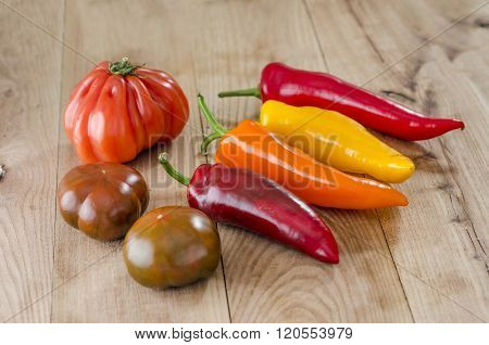 Orange, Yellow And Red Bell Pepper And Costoluto Genovese Tomato
