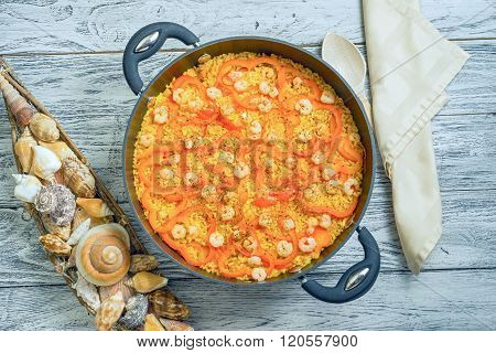 View From Above Of Paella With Pepper In A Paellera On A Wooden Background