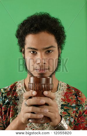 Portrait of man holding chalice
