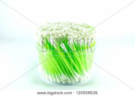 cotton bud on white background. green  cotton bud