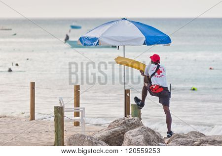 Lifeguard Patrolling The Beach