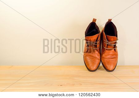 Still Life With Brown Leather Shoes With Wooden Shoe Stretchers On Wooden Table