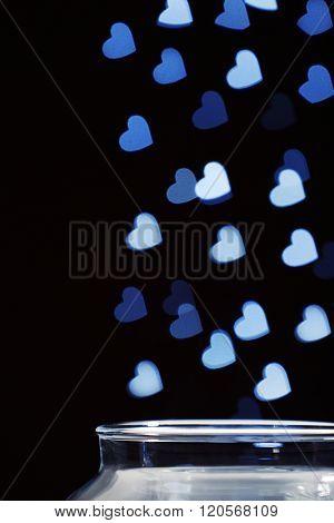 Love magic bottle on black background