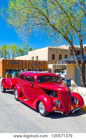 Taos, U.S.A. - May 22, 2011: A restored old car in the country center,