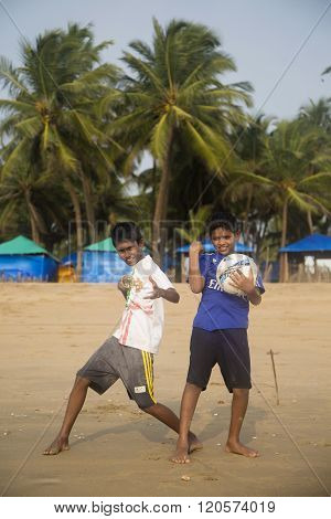 AGONDA, INDIA - OCTOBER 13, 2015: Unidentified children at Agonda beach at Goa India. This 3 km beach in South Goa is famous as a Ridley turtle nesting site.