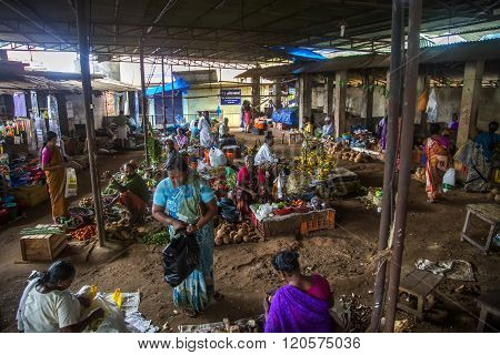 VARKALA, INDIA - OCTOBER 18, 2015: Unidentified vendors wait for customers in a crowded market.