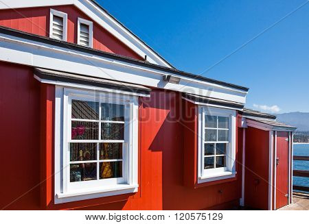 Santa Barbara, U.S.A. - June 1, 2011: Detail of a traditional red house in the Stearns Wharf on the sea front.