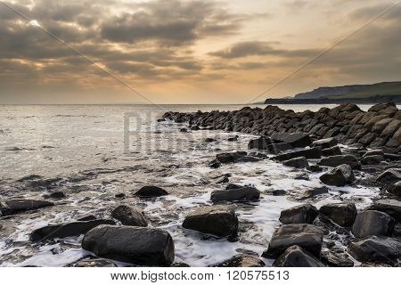 Beautiful Sunset Landscape Image Of Rocky Coastline In Kimmeridge Dorset England