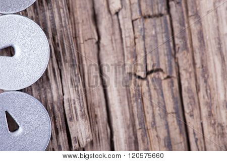 abstract vertical background rotten boards and round hats pushpin