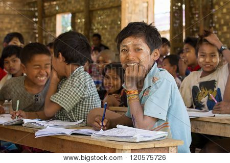 MRAUK-U MYANMAR - JANUARY 27 2016: Unidentified Burmese girls and boys in a local school during the lesson