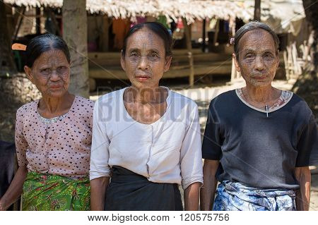 MRAUK-U MYANMAR - JANUARY 27 2016: The portrait of Chin women with spider tattoo. Chin people also known as the Kukis are a number of Tibeto Burman tribal people.