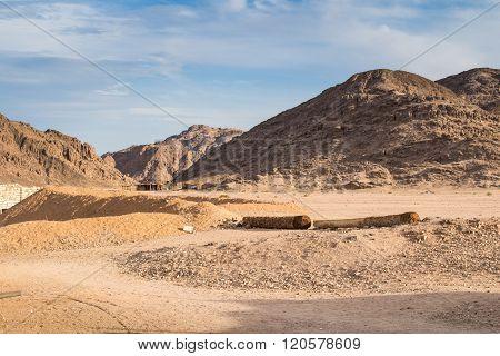 Mountains Of Egyptian Desert And Bedouin Village