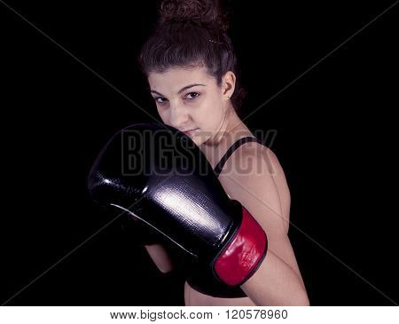 Young Attractive Girl With Boxing Gloves In Fighting Stance