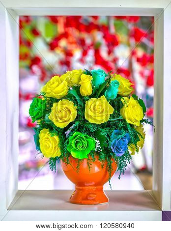 Potted roses frozen inside window frame colors