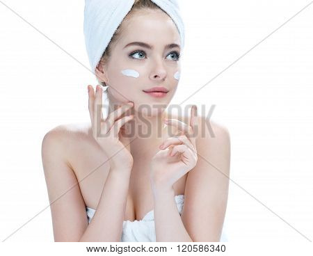 Skin care teenage girl putting face cream.