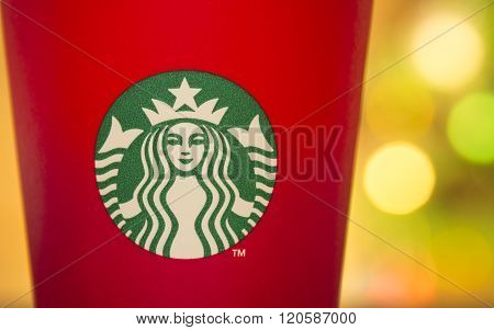 Bangkok Thailand - November 5 2015: The new paper cup of Starbucks stores in the country for the Christmas on a red background cup. Starbucks brand is one of the world famous from USA.