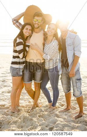 Friends  at the beach having fun together