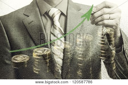 Businessman Drawing Rising Graph With Coins, Development And Growth Concept