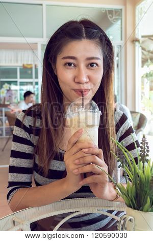 Happy Women Drinking Frappe Coffee In Cafe