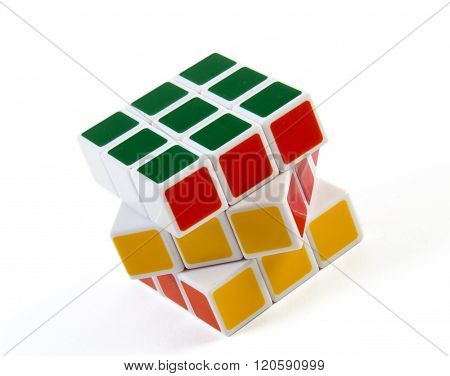 solved  rubik cube isolated on white background