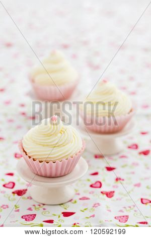 Three vanilla cupcakes