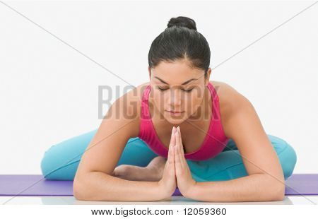 Teen girl stretching in yoga position
