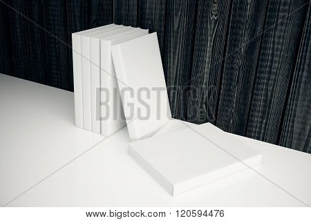 White Book Leaning On Wooden Wall