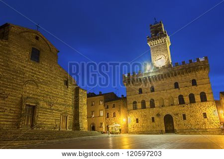 The Cathedral of Santa Maria Assunta and Communal Palace in Montepulciano in Italy in the evening
