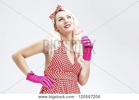 Pinup Retro Concepts. Dreaming Sensual Pinup Blond Woman With Sweet Candy Posing In Polka Dot Dress